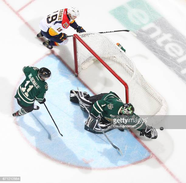 Dylan Strome of the Erie Otters tries to get to a puck before Tyler Parsons of the London Knights can cover it up in Game Six of the OHL Western...