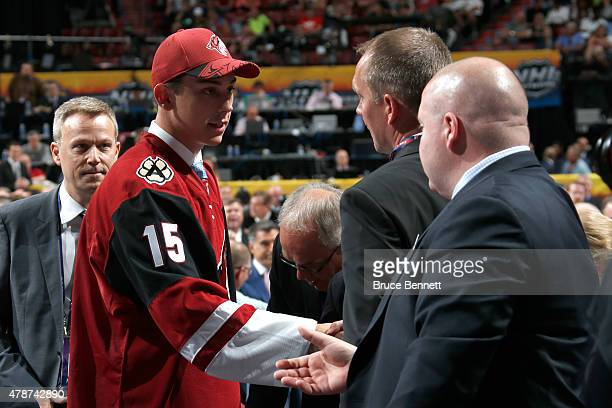 Dylan Strome smiles after being selected third overall by the Arizona Coyotes in the first round of the 2015 NHL Draft at BBT Center on June 26 2015...