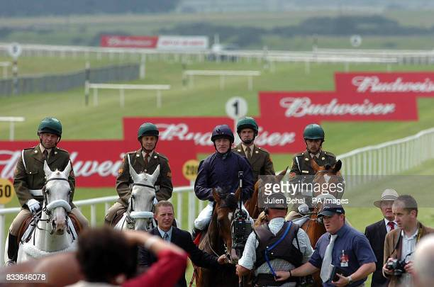 Dylan Thomas and jockey Kieren Fallon are led back after winning the Irish Budweiser Derby at the Curragh racecourse Kildare Ireland