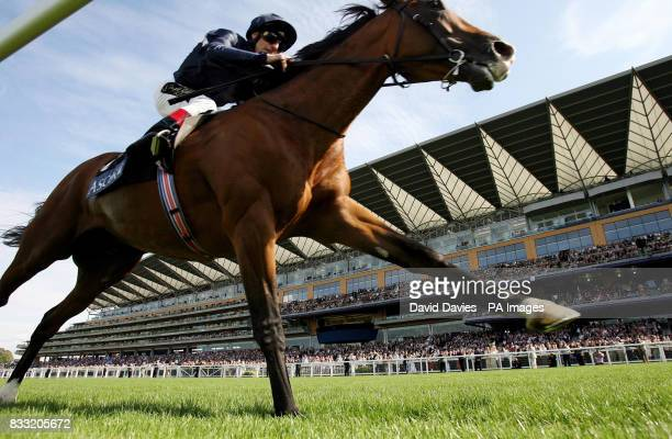 Dylan Thomas ridden by Jonny Murtagh wins the King George VI and Queen Elizabeth Stakes at Ascot Racecourse