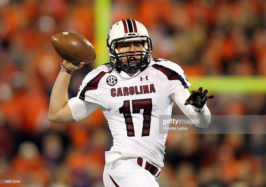 Dylan Thompson #17 of the South Carolina Gamecocks drops back to pass during their game against the Clemson Tigers at Memorial Stadium on November 24, 2012 in Clemson, South Carolina.
