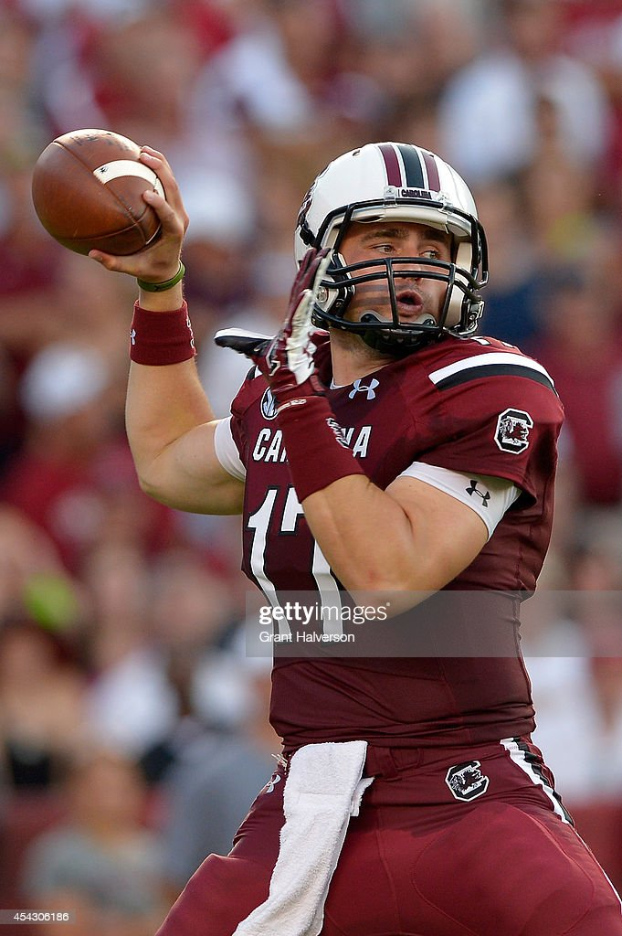 Dylan Thompson #17 of the South Carolina Gamecocks drops back to pass against the Texas A&M Aggies during their game at Williams-Brice Stadium on August 28, 2014 in Columbia, South Carolina.
