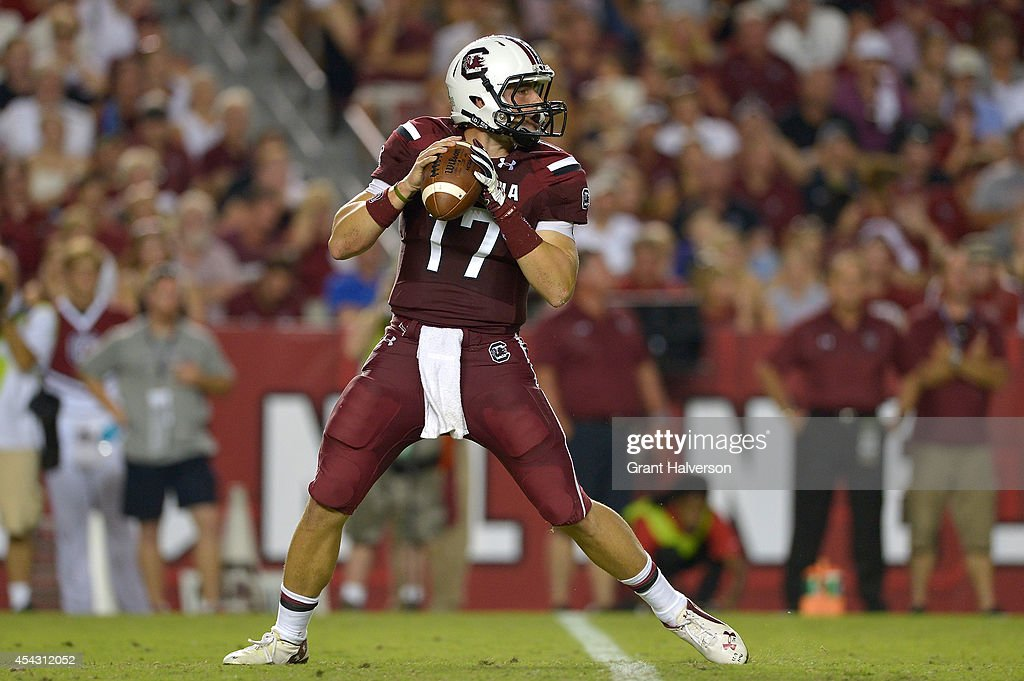 Dylan Thompson #17 of the South Carolina Gamecocks drops back to pass against the Texas A&M Aggies during their game at Williams-Brice Stadium on August 28, 2014 in Columbia, South Carolina. Texas A&M won 52-28.