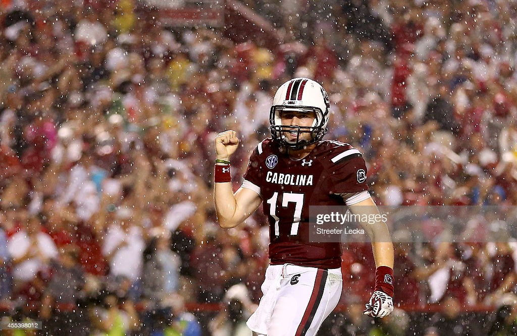 Dylan Thompson of the South Carolina Gamecocks reacts after a touchdown against the Georgia Bulldogs during their game at WilliamsBrice Stadium on...