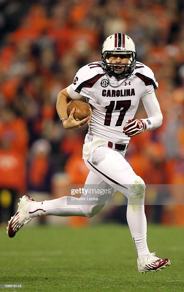 Dylan Thompson #17 of the South Carolina Gamecocks runs with the ball during their game against the Clemson Tigers at Memorial Stadium on November 24, 2012 in Clemson, South Carolina.