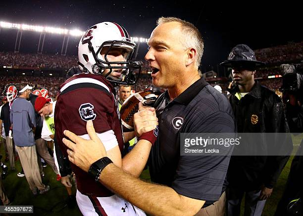 Dylan Thompson of the South Carolina Gamecocks shakes hands with head coach Mark Richt of the Georgia Bulldogs after the Gamecocks defeated the...