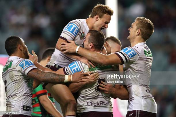 Dylan Walker Daly CherryEvans Blake Green and Tom Trbojevic of the Sea Eagles celebrate Blake Green scoring a try during the round nine NRL match...