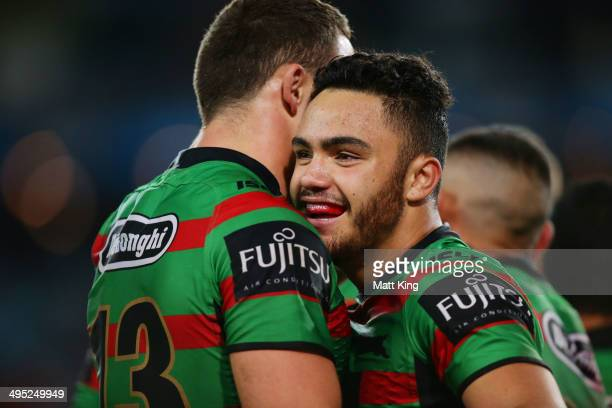 Dylan Walker of the Rabbitohs celebrates with Sam Burgess after scoring a try during the round 12 NRL match between the South Sydney Rabbitohs and...