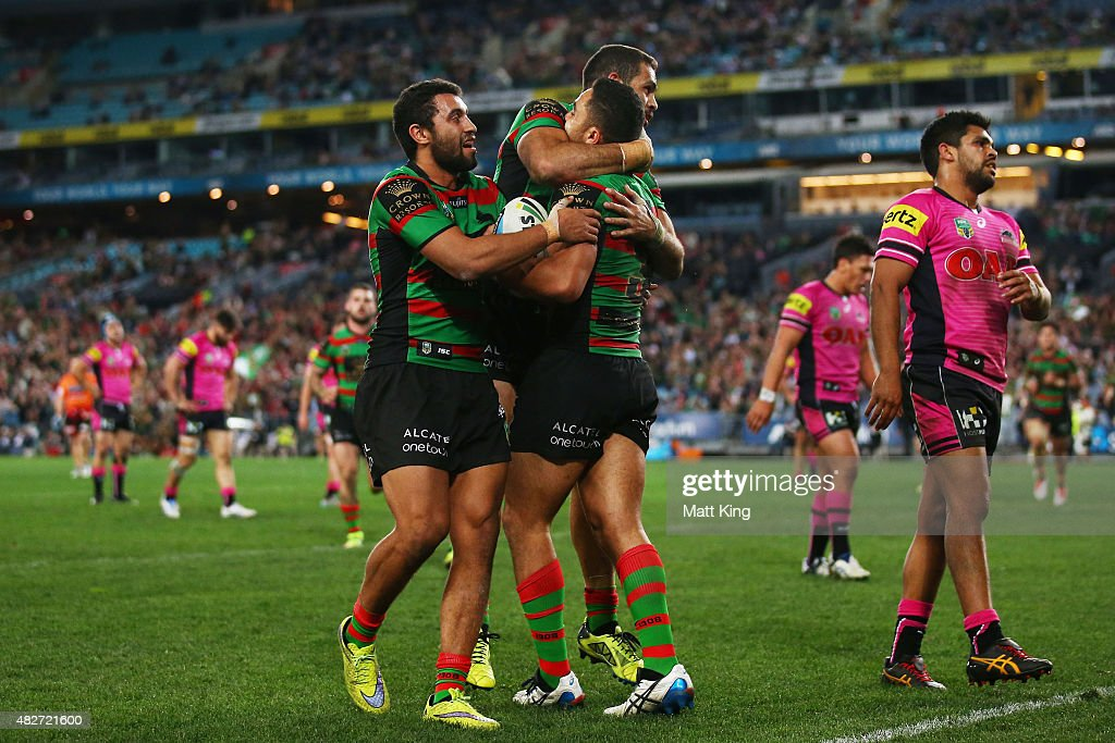Dylan Walker of the Rabbitohs celebrates with team mates after scoring a try during the round 21 NRL match between the South Sydney Rabbitohs and the Penrith Panthers at ANZ Stadium on August 2, 2015 in Sydney, Australia.