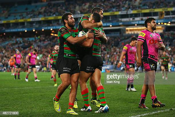 Dylan Walker of the Rabbitohs celebrates with team mates after scoring a try during the round 21 NRL match between the South Sydney Rabbitohs and the...