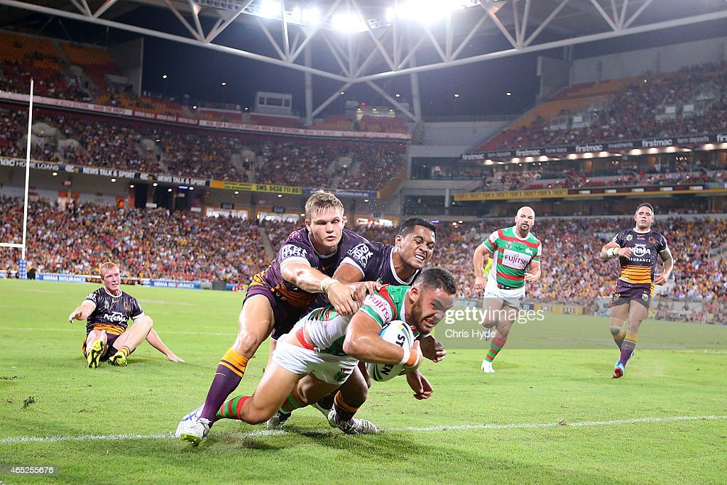 Dylan Walker of the Rabbitohs dives to score a try during the round one NRL match between the Brisbane Broncos and the South Sydney Rabbitohs at Suncorp Stadium on March 5, 2015 in Brisbane, Australia.