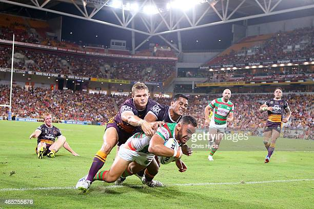Dylan Walker of the Rabbitohs dives to score a try during the round one NRL match between the Brisbane Broncos and the South Sydney Rabbitohs at...