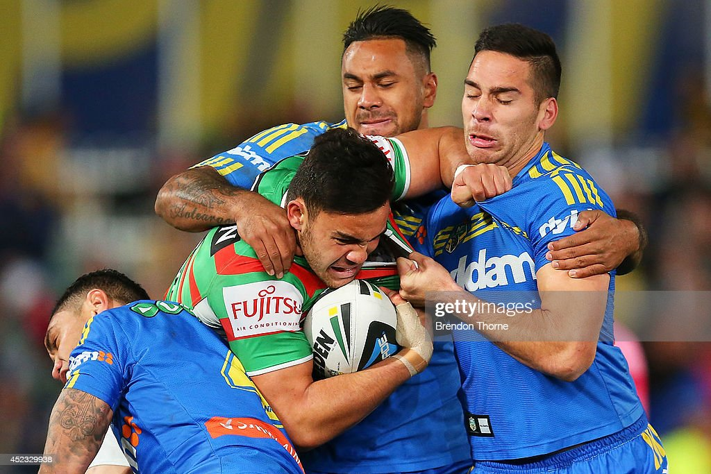 <a gi-track='captionPersonalityLinkClicked' href=/galleries/search?phrase=Dylan+Walker&family=editorial&specificpeople=10506368 ng-click='$event.stopPropagation()'>Dylan Walker</a> of the Rabbitohs is tackled by the Eels defence during the round 19 NRL match between the Parramatta Eels and the South Sydney Rabbitohs at Pirtek Stadium on July 18, 2014 in Sydney, Australia.