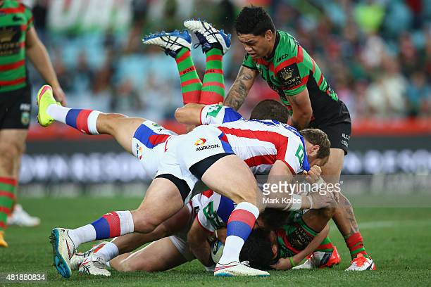 Dylan Walker of the Rabbitohs is tackled dangerously during the round 20 NRL match between the South Sydney Rabbitohs and the Newcastle Knights at...
