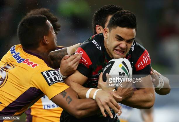 Dylan Walker of the Rabbitohs is tackled during the round 23 NRL match between the South Sydney Rabbitohs and the Brisbane Broncos at ANZ Stadium on...