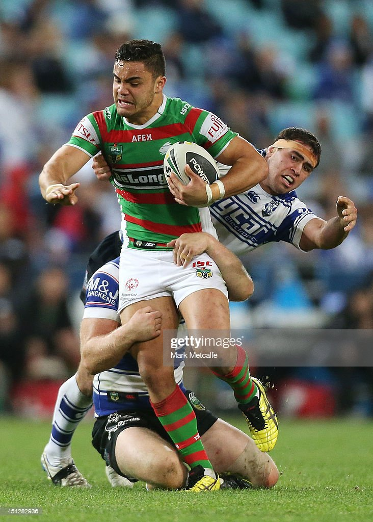 Dylan Walker of the Rabbitohs is tackled during the round 25 NRL match between the Canterbury Bulldogs and the South Sydney Rabbitohs at ANZ Stadium on August 28, 2014 in Sydney, Australia.