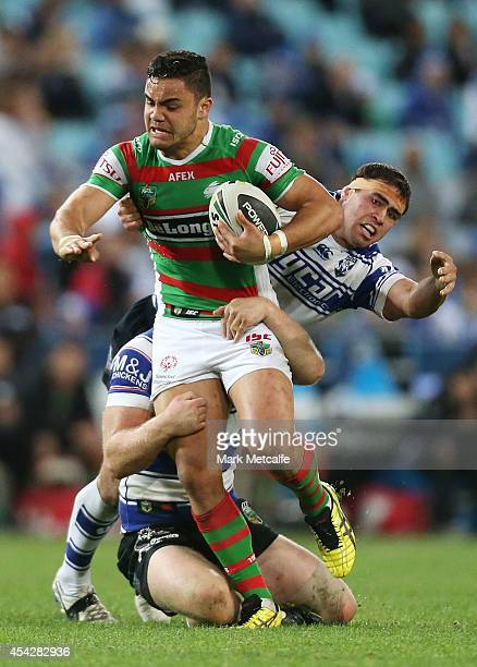 Dylan Walker of the Rabbitohs is tackled during the round 25 NRL match between the Canterbury Bulldogs and the South Sydney Rabbitohs at ANZ Stadium...