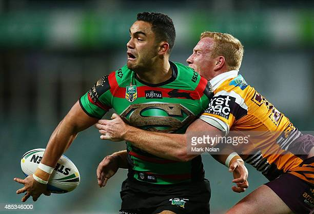Dylan Walker of the Rabbitohs offloads during the round 25 NRL match between the South Sydney Rabbitohs and the Brisbane Broncos at Allianz Stadium...