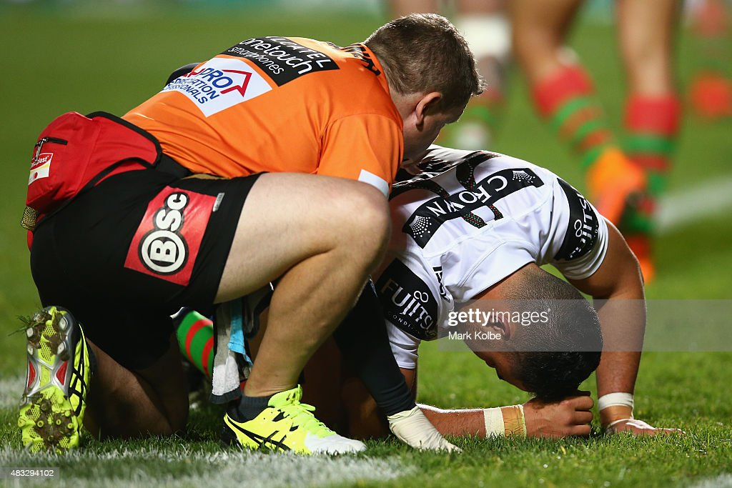 Dylan Walker of the Rabbitohs receives attention from the trainer during the round 22 NRL match between the Manly Sea Eagles and the South Sydney Rabbitohs at Brookvale Oval on August 7, 2015 in Sydney, Australia.