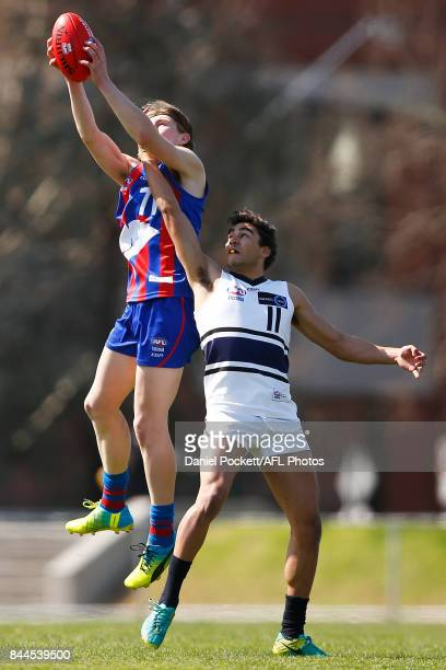 Dylan Williams of the Chargers and Ethan Penrith of the Knights contest the ball during the TAC Cup Final between Oakleigh and Northern Knights at...