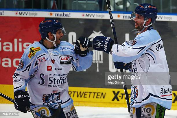 Dylan Yeo of Straubing celebrates his team's second goal with team mate Thomas Brandl during the DEL match between Adler Mannheim and Straubing...