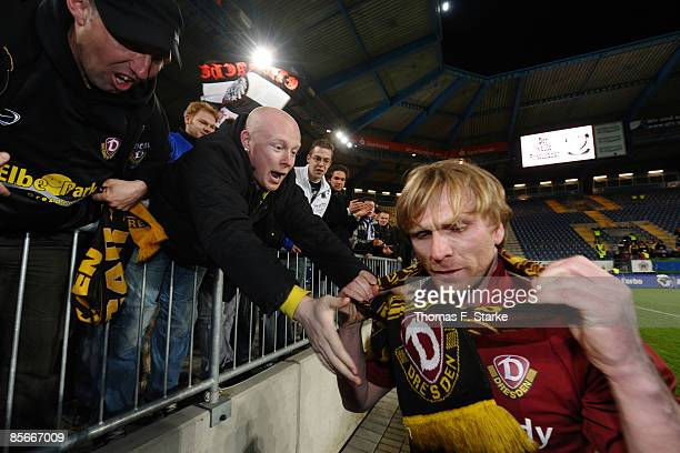 Dynamo Dresden Supporters give a scarf to Ansgar Brinkmann after the Ansgar Brinkmann Farewell Match at the Schueco Arena on March 27 2009 in...
