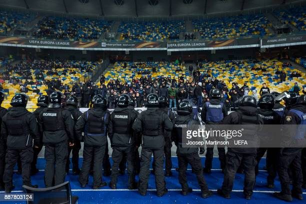 Dynamo fans chant as police looks on during the UEFA Europa League group B match between FC Dynamo Kyiv and FK Partizan Belgrade at NSK Olimpiyskyi...