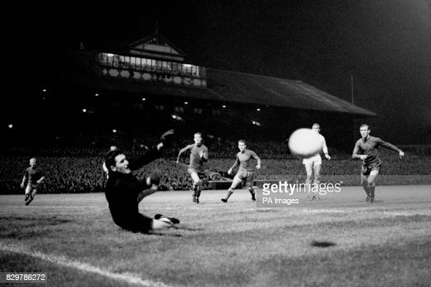 Dynamo Kiev goalkeeper Roudakou dives to make a save as Celtic's Jimmy Johnstone Steve Chalmers Willie Wallace and Bobby Lennox look on