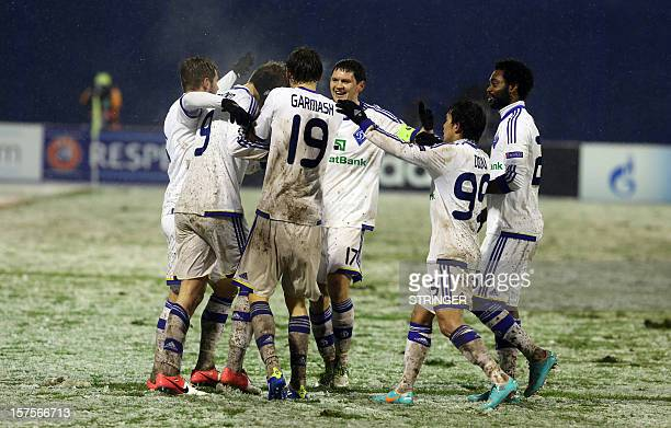 FC Dynamo Kiev player Andriy Yarmolenko celebrates with his teamates after scoring during the UEFA Champions League group A football match FC Dynamo...