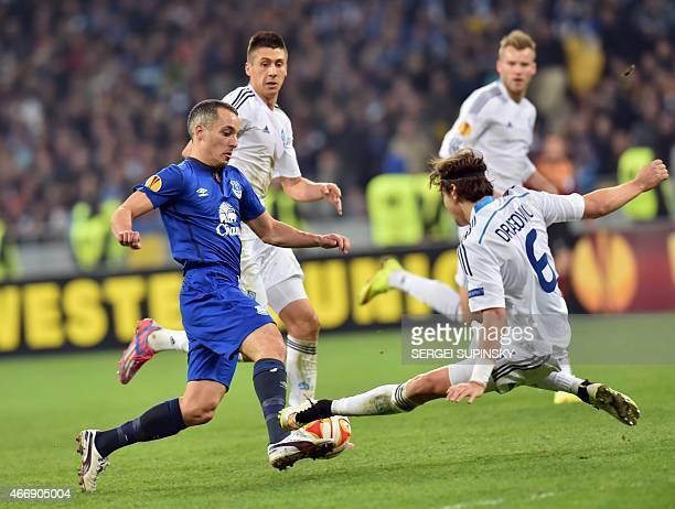 FC Dynamo Kiev's Aleksandar Dragovic and Everton FC's Leon Osman vie for the ball during the UEFA Europa League round of 16 football match between...