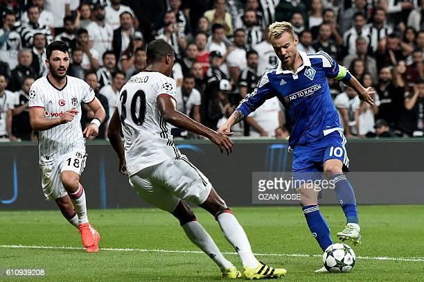 Dynamo Kiev's Andriy Yarmolenko vies for the ball with Besiktas' Marcelo and Tolga Arslan during the UEFA Champions League football match Besiktas...