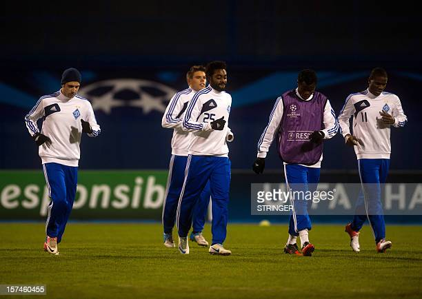 FC Dynamo Kiev's Croatian midfielder Ognjen Vukojevic Nigerian midfielder Lukman Haruna Nigerian defender Taye Taiwo and Nigerian forward Ideye Brown...