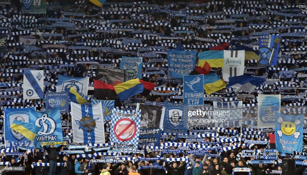 Dynamo Kiev's fans cheer for their team during the UEFA Europa League round of 16 football match between Dynamo Kiev and Everton in Kiev on March 19, 2015.