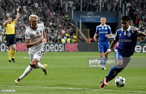 Dynamo Kiev's Junior Moraes vies for the ball with Besiktas' Andreas Beck during the UEFA Champions League football match Besiktas versus Dynamo Kiev...