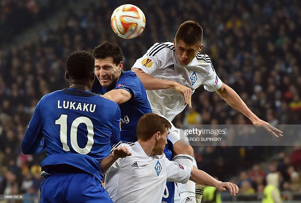 Dynamo Kiev's Yevhen Khacheridi (R) jumps to head the ball with Everton's Antolin Alcaraz during the UEFA Europa League round of 16 football match between Dynamo Kiev and Everton in Kiev on March 19, 2015.