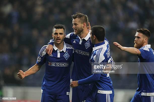 Dynamo Kyiv's forward Andriy Yarmolenko celebrates scoring Dynamo's goal with his team mates during the Champions League match between FC Porto and...