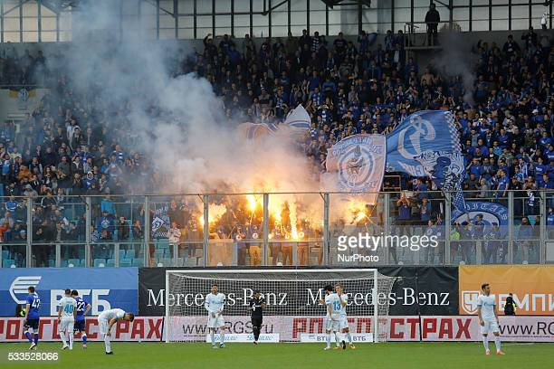 FC Dynamo Moscow supporters light flares during the Russian Football Premier League match between FC Dynamo Moscow and FC Zenit St Petersburg at...