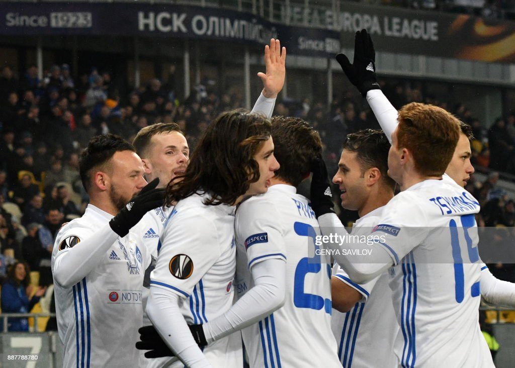 Dynamo's Mykola Morozyuk (L) celebrates with his teammates after scoring during the UEFA Europa League group stage football match between Dynamo Kyiv and FK Partizan in Kiev on December 7, 2017. /