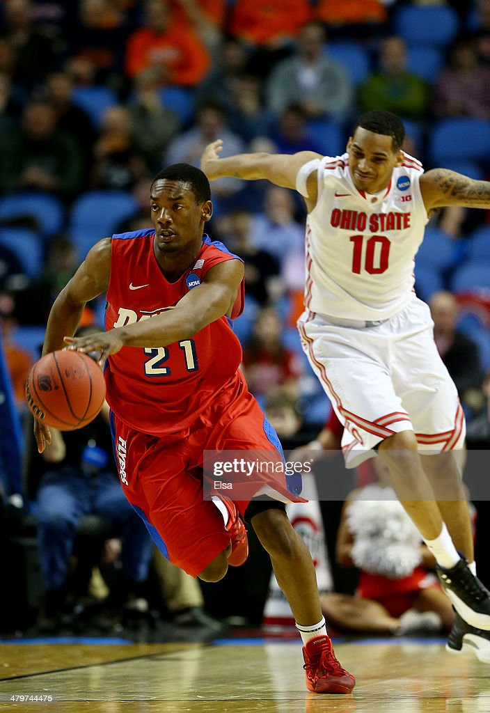 Dyshawn Pierre of the Dayton Flyers brings the ball up the floor against the Ohio State Buckeyes during the second round of the 2014 NCAA Men's...
