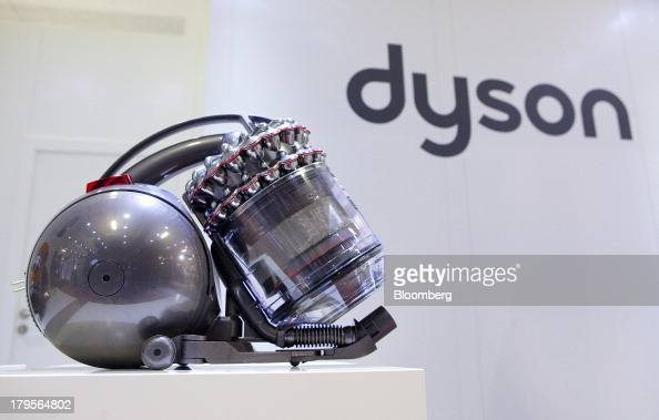 A Dyson Cinetic DC 52 Animal Complete vacuum cleaner manufactured by Dyson Ltd sits on display on the eve of the opening of the IFA consumer...