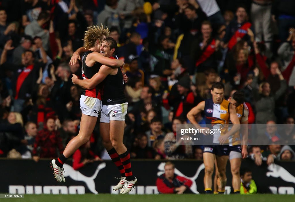 Dyson Heppell and <a gi-track='captionPersonalityLinkClicked' href=/galleries/search?phrase=Jobe+Watson&family=editorial&specificpeople=235888 ng-click='$event.stopPropagation()'>Jobe Watson</a> and of the Bombers celebrate the winning goal during the round 14 AFL match between the West Coast Eagles and the Essendon Bombers at Patersons Stadium on June 27, 2013 in Perth, Australia.