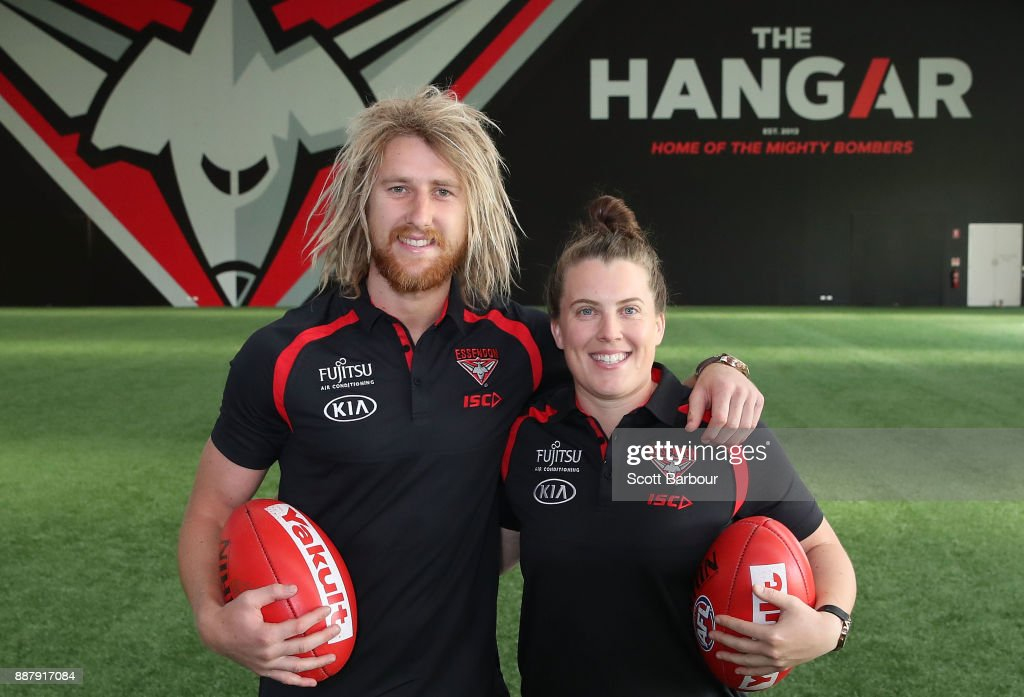 Dyson Heppell and Lauren Morecroft of the Bombers pose at 'The Hangar' during an Essendon Bombers Media Announcement & Training Session at Essendon Football Club on December 8, 2017 in Melbourne, Australia.
