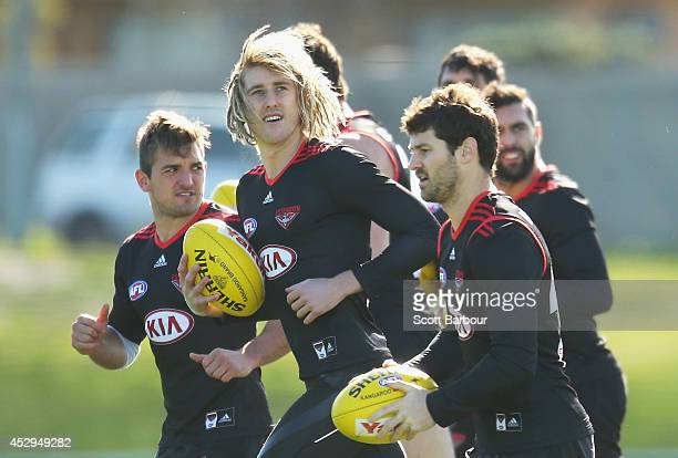 Dyson Heppell and the Bombers run in the strong winds during an Essendon Bombers AFL training session at True Value Solar Centre on July 31 2014 in...