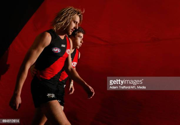 Dyson Heppell and Zach Merrett of the Bombers come up the race during the 2017 AFL round 12 match between the Essendon Bombers and the Port Adelaide...