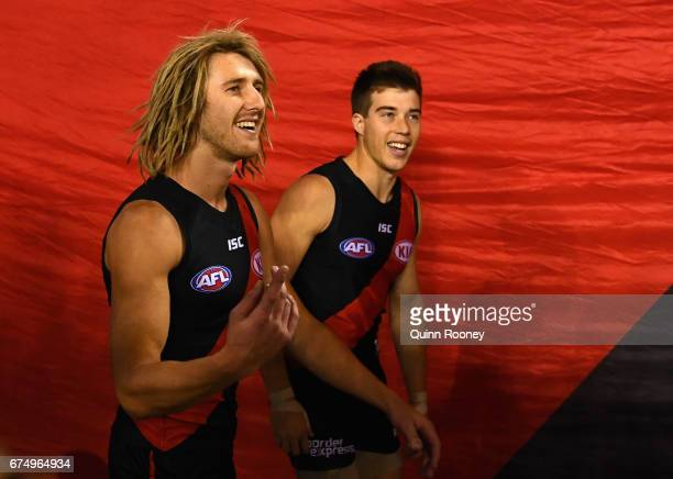 Dyson Heppell and Zach Merrett of the Bombers lead their players onto the field during the round six AFL match between the Essendon Bombers and the...