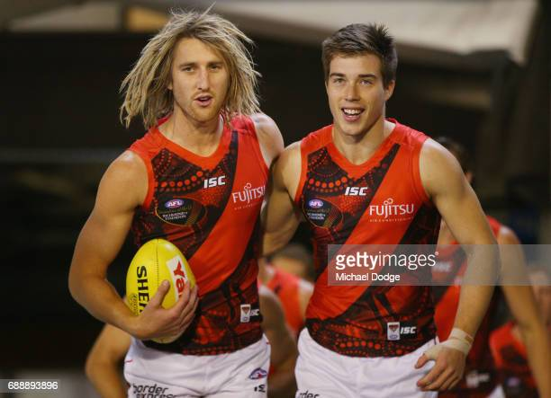 Dyson Heppell and Zach Merrett of the Bombers leads the team out during the round 10 AFL match between the Richmond Tigers and the Essendon Bombers...