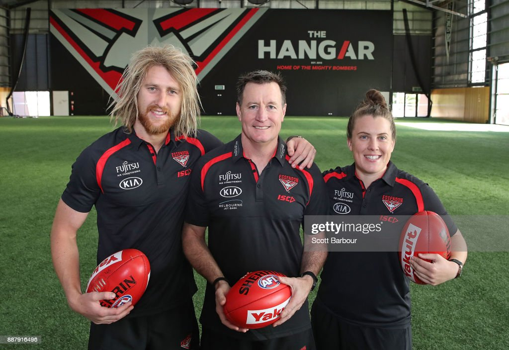 Dyson Heppell, coach John Worsfold and Lauren Morecroft of the Bombers pose at 'The Hangar' during an Essendon Bombers Media Announcement & Training Session at Essendon Football Club on December 8, 2017 in Melbourne, Australia.