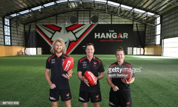 Dyson Heppell coach John Worsfold and Lauren Morecroft of the Bombers pose at 'The Hangar' during an Essendon Bombers Media Announcement Training...