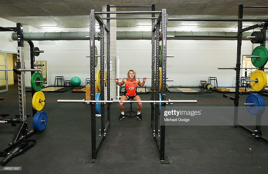 Dyson Heppell lifts weights at the new Essendon Bombers AFL training facility at Tullamarine on November 18, 2013 in Melbourne, Australia.