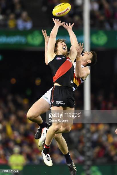 Dyson Heppell of the Bombers and Jake Lever of the Crows compete for a mark during the round 21 AFL match between the Essendon Bombers and the...